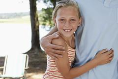 Stock Photo of Girl Embracing Father