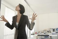 Businesswoman Trapped In Office - stock photo