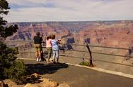 Stock Photo of tourists enjoy the view overlooking the south rim