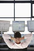 Stock Trader Watching Multiple Monitors Stock Photos