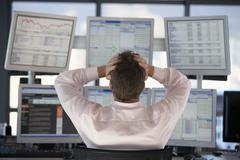 Stock Trader Watching Computer Screens With Hands On Head Stock Photos
