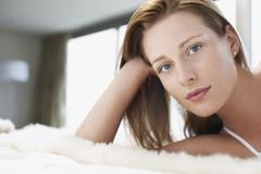 Stock Photo of Beautiful Woman Relaxing In Bed