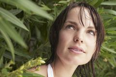 Woman Looking Out From Shrub - stock photo