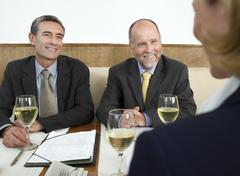 Stock Photo of Business People Discussing In Restaurant