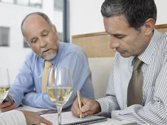 Businessman Signing Contract At Restaurant Stock Photos
