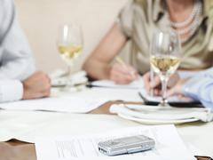 Businesspeople Working In Restaurant - stock photo