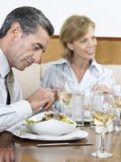 Businesspeople Having Food At Restaurant - stock photo