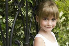 Girl Leaning On Fence - stock photo