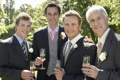 Men Holding Champagne Flutes At Wedding Stock Photos