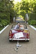 Newlywed Couple In Retro Wedding Car - stock photo