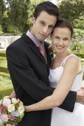 Newlywed Couple Embracing - stock photo
