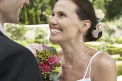Bride And Groom In Garden - stock photo
