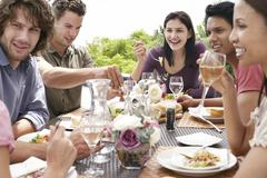 Friends Enjoying Dinner Party Outdoors - stock photo