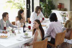 Woman With Friends Having A Dinner Party At Home - stock photo