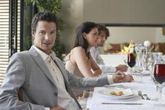 Man With Friends Having Formal Dinner Party Stock Photos