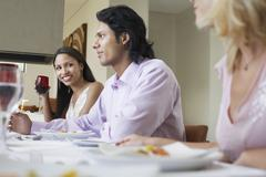 Friends Enjoying Dinner Party At Home - stock photo