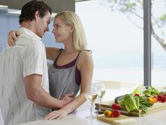 Couple Embracing With Fresh Vegetables On Kitchen Counter Stock Photos