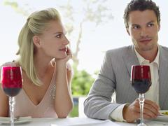 Stock Photo of Woman Admiring Man At Dinner Table