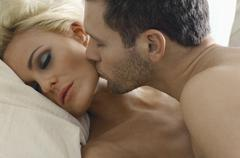 Loving Couple In Bed - stock photo