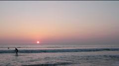 Malibu Beach Sunset With Paddle Boarder Stock Footage