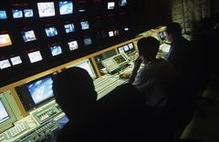 Operators In Central Control Room At Television Station Stock Photos