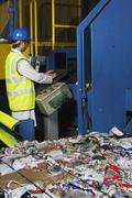 Worker Operating Conveyor Belt In Recycling Factory Stock Photos