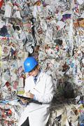 Supervisor Writing On Clipboard In Recycling Factory Stock Photos