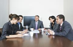 Stock Photo of Business People Having Discussion In Conference Room