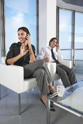 Business People Using Cell Phones In Office - stock photo