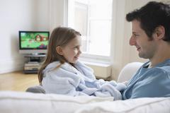 Father And Daughter On Sofa Stock Photos