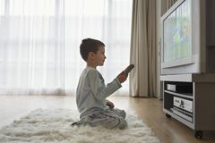 Boy Watching Cartoons In TV - stock photo