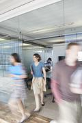 Blurred Executives Leaving Conference Room - stock photo