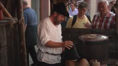 Hatter making hats - Mittenwald, Germany - Bozner Markt 2012 Stock Footage