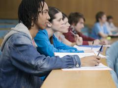 College Students Studying In Class Stock Photos