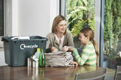Woman And Girl Preparing Waste Paper For Recycling Stock Photos