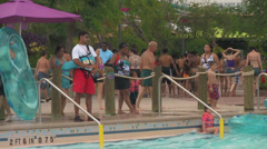 Waterpark Lifeguard at Waterslide Swimming Pool Stock Footage