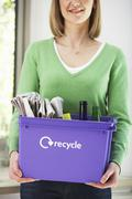 Stock Photo of Midsection Woman With Recycling Container