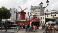 Stock Video Footage of Famous Iconic Moulin Rouge Cabaret Show Paris Car Traffic People Passing Walking