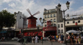 Famous Iconic Moulin Rouge Entertainment Show Paris Car Traffic People Passing Footage