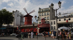 Famous Iconic Moulin Rouge Entertainment Show Paris Car Traffic People Passing Stock Footage