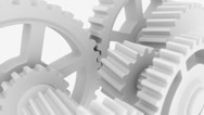 Stock Video Footage of Rotating white cogwheels
