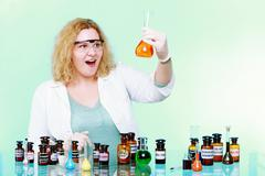 Chemist woman or girl student or female laboratory assistant Stock Photos
