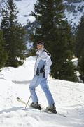 Female Skier Standing On Ski Slope Stock Photos