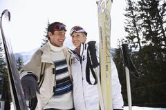 Happy Skiing Couple In Warm Clothing With Skis Stock Photos