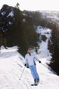 Woman Skiing Down Slope Stock Photos