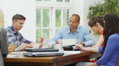 Attractive casual business team in relaxed company meeting - stock footage