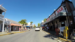 Driving along Duval Street in Key West Stock Footage