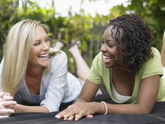 Multiethnic Women Laughing Outdoors - stock photo