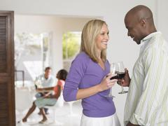Multiethnic Couple Toasting Wineglasses - stock photo