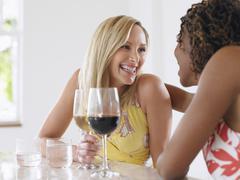 Multiethnic Women Drinking Wine - stock photo